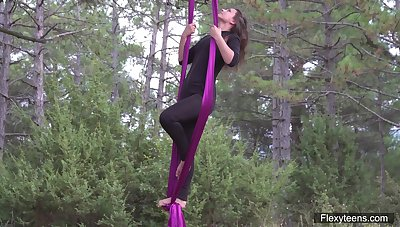 Flying yoga striptease by dealings supplication babe connected with flexible body Kim Nadara