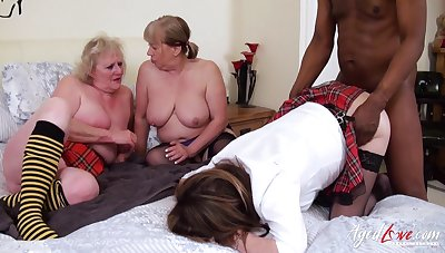 Three old chubby women put on college uniform with the addition of fuck one black dude