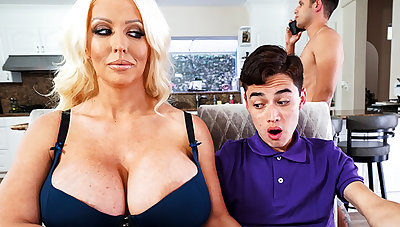 Well-endowed stepmom interested to taste schoolboy's dick